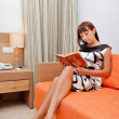 Woman is reading book — Stock Photo #26387863