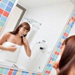 Dental care.Woman cleans a teeth — Stock Photo