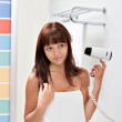 Woman hairdrying — Stock Photo