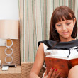 Stock Photo: Woman is reading book