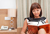 Woman is reading book — Stockfoto