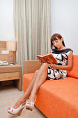 Woman is reading book — 图库照片