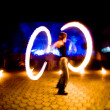 Girl with fire, blurred motion — Stock Photo #1251561