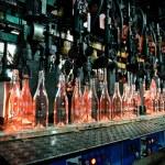 Bottle factory, row of glass bottles — Stock Photo