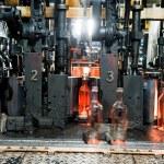 Bottle factory, process of making glass bottles — Stock Photo