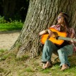 Hippie girl with guitar — Stock Photo