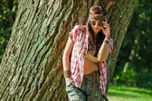 Hippie girl near tree — Stock Photo