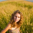 Young woman on a summer field — Stock Photo #1194952