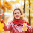 Young woman throwing leaves — Stock Photo #1195494