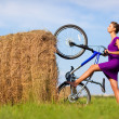Young woman with bicycle at the field — Stockfoto #1362406
