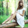 Young woman in forest — Stock Photo #1369000