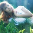 Young woman lying on grass — Stock Photo #1369145