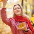 Young woman throwing leaves — Stock Photo #1372656