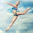 Young slim woman jumping — Stock Photo #17473775