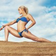 Stock Photo: Young slim woman stretching