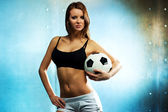 Young sexy football player — Stock Photo