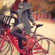 Stock Photo: Young womwith bike