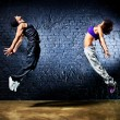 Young dancer couple jumping — Stock Photo