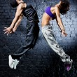 Young dancer couple jumping — Stock Photo #6912804