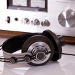 Headphones connected to audio stereo devices — Stock Photo #12705407