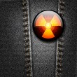 Radioactivity badge on black denim texture vector - Stock Vector