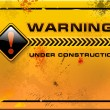 Stock Vector: Under Construction, yellow grunge warning sign vector