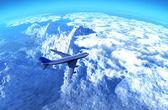 The plane over mountains — Stock Photo