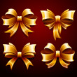 Vector set of beautiful gold gift bows — Imagens vectoriais em stock