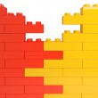 Wall from color plastic blocks — Stock Photo #13423576