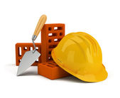 Helmet with bricks and trowel — Stock Photo