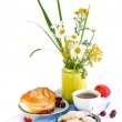 Still life with flowers and red currant bun — Stock Photo #29673301