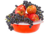 Ripe red apples and grapes on a plate — Stock Photo