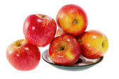 Ripe red apples on a plate — Stock Photo