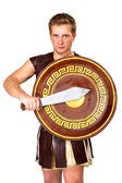 Young male warrior with a shield — Stock Photo