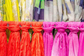 Colored scarves tied like a tie — Stock Photo