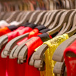 T-shirts hanging on a hanger in the store — Stock Photo