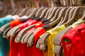 T-shirts hanging on a hanger in the store — Zdjęcie stockowe