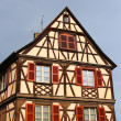 Traditional half-timbered house in Colmar, France - Stock Photo