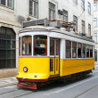 Old yellow Lisbon tram, Portugal — Stock Photo #27340289