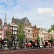 Amsterdam cityscape with bikes on the bridge — Stock Photo