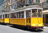 Yellow trams in Lisbon — Stok fotoğraf