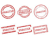 Fragile stamps — Stock Vector