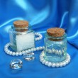 Spa composition with white pearls on the blue silk - Stock Photo