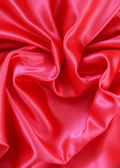 Red heart from red silk for St Valentine's day background — Stock fotografie