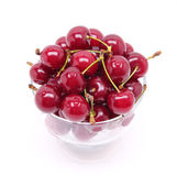 Ripe fresh cherry in the glass — Stock Photo
