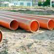 Several plastic pipes used in construction - Stock Photo