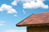 Roof and the sky with clouds — Stock Photo