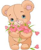 Teddy bear giving hearts bouquet — Stock Vector