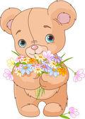 Teddy bear giving bouquet — Stock Vector