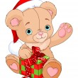 Stock Vector: Christmas Teddy Bear holding gift